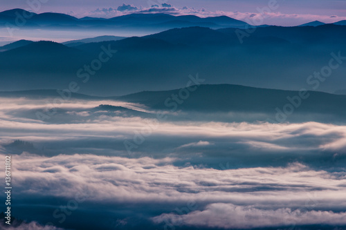 Foto op Aluminium Nachtblauw Beautiful foggy landscape in the mountains.