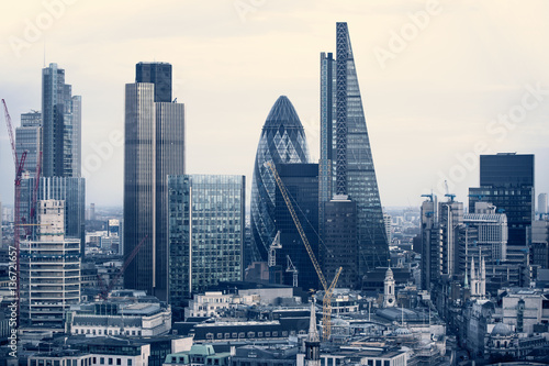 Photo Stands London City of London business aria view at sunset. View includes Gherkin and modern skyscrapers of leading financial companies