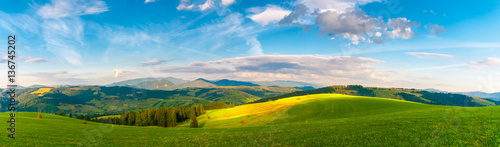 Foto op Canvas Blauw Panorama Carpathian mountain landscape with blue cloudy sky in summer