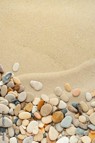 Fotomural  Sand background with pebbles. Sandy beach texture