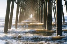 Waves Under The Pier, In Folly Beach, South Carolina.