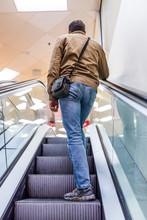 Man On Escalator Going Up Indo...