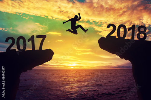 Fotografia, Obraz  A man jump between 2017 and 2018 years.