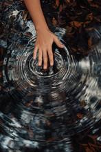 Woman Hand Making Circles On Water