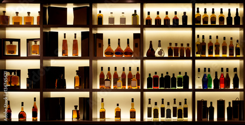 Fotobehang Bar Various alcohol bottles in a bar, back light, logos removed