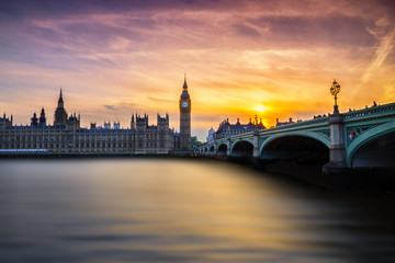 Westminster's sunset with Big Ben, Parliament and river Thames.