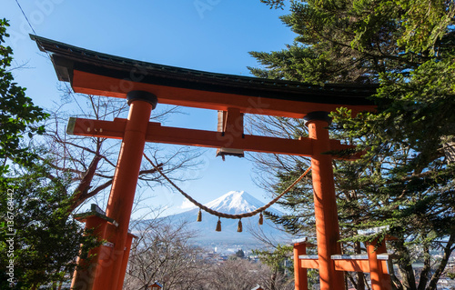Red torii of Chureito temple with Mount Fuji as background. The