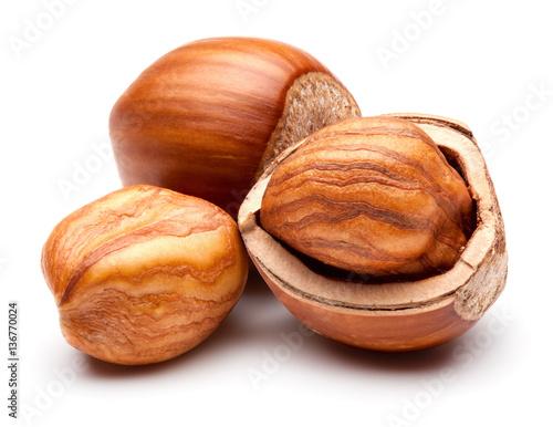 Hazelnuts isolated on white.