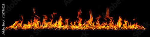 Fire panorama on a black background. Wallpaper Mural