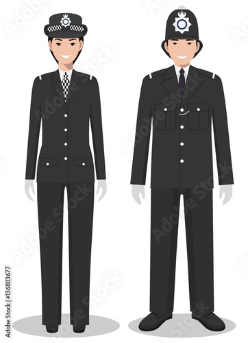 Fototapeta Couple of british policeman and policewoman in traditional uniforms standing together on white background in flat style