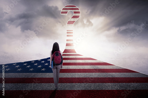 Photo  Female student with USA flag at highway