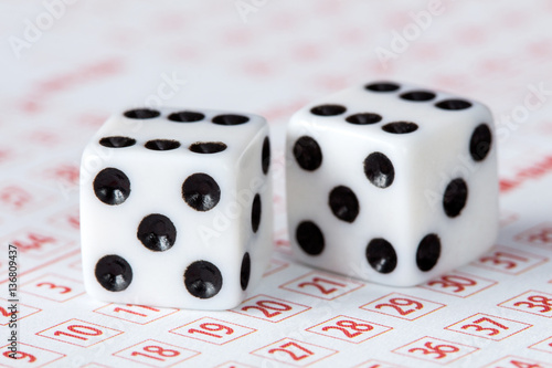 Close-up of dices on lottery ticket Obraz na płótnie