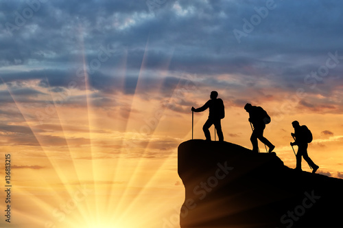 Fototapety, obrazy: Silhouette climbers ascending to top of mountain