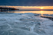 Sunset over frozen Baltic Sea in winter. Poland.