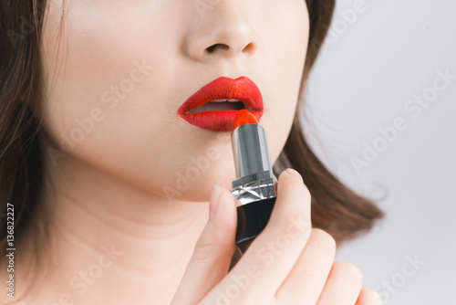 Young asian sexy woman with dark hair using red lipstick Poster