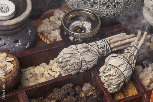 Carta da parati Incense of Salvia Apiana (White sage, sacred sage, bee sage, california sage) and various kinds of incense: myrrh, frankincense, gowe, palo santo