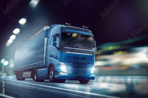 Fototapeta Ciężarówka jedzie na drodze w nocy