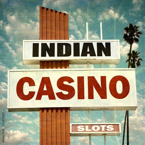 фотография  aged and worn vintage photo of indian casino sign
