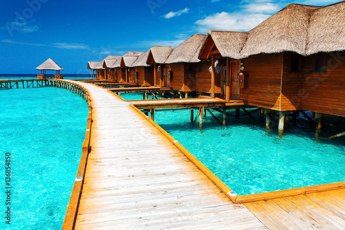 Water bungalows resort at islands. Indian Ocean, Maldives Wallpaper Mural