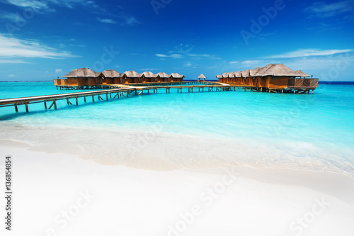 Water bungalows resort at islands. Indian Ocean, Maldives Canvas Print