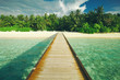 Wooden pier at tropical island resort. Indian Ocean, Maldives