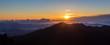 sunrise above the clouds at 10000 feet from the summit of Haleakala volcano on the tropical hawaiian island of Maui