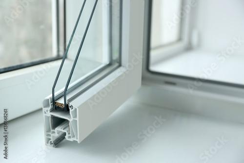 Fototapeta Sample of window profile on windowsill, closeup