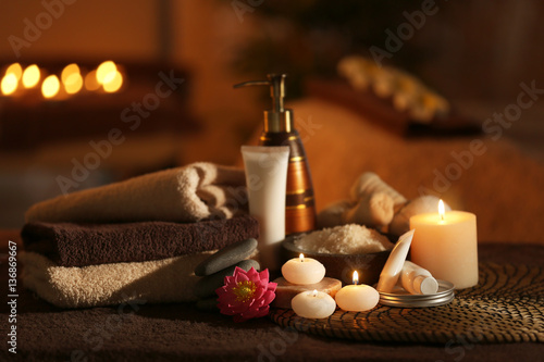 Natural treatments and alight candles in spa salon Canvas Print