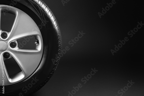 Fotografie, Obraz  Modern car wheel on black background
