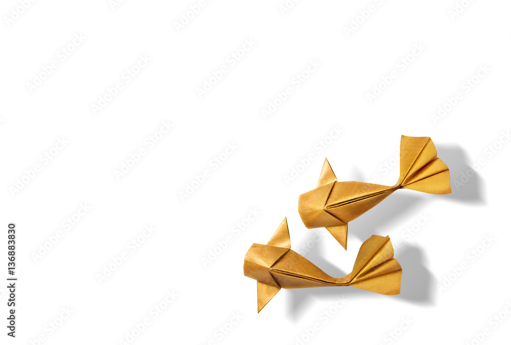 Fototapeta Handmade paper craft gold color origami koi carp fish on white background with empty space.