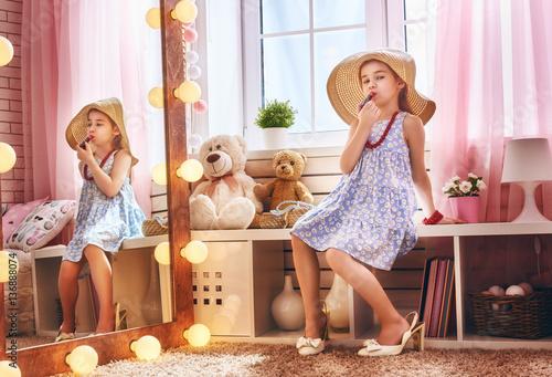 Fotografie, Obraz  girl dresses up at home