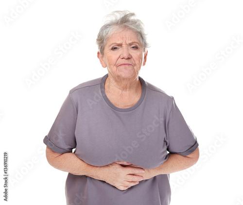 Valokuva Elderly woman suffering from stomach ache on white background