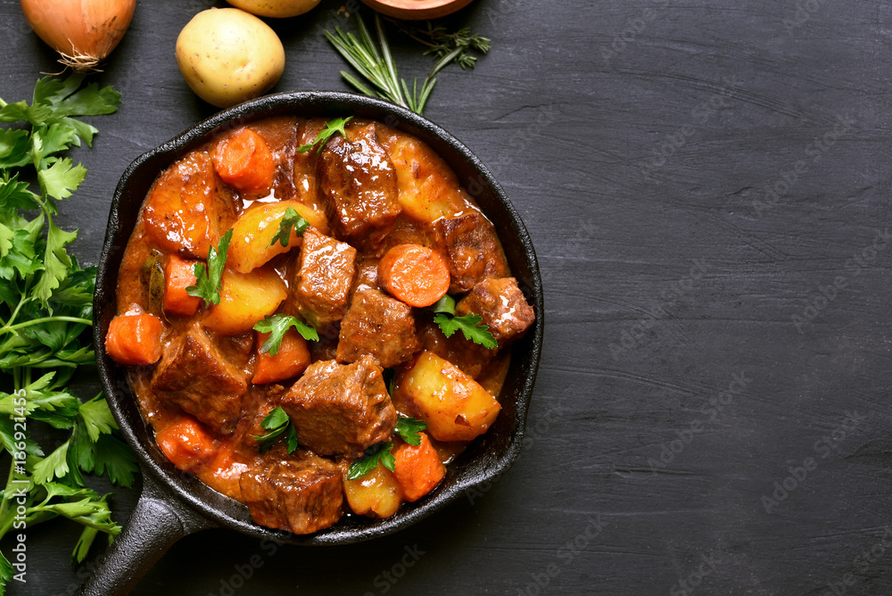 Fototapeta Beef stew with potatoes, carrots and herbs