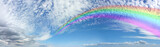 Fototapeta Tęcza - Vast Rainbow Panorama on Mackerel Blue Sky Cloudscape - Wide blue sky banner with a pretty mackerel cloud formation and a huge rainbow spanning from right to left disappearing into the distance