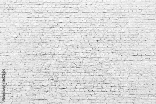 Fotografia  White brick wall, old surface texture of stone blocks