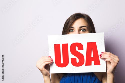 girl holds USA sign Tapéta, Fotótapéta