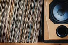 Wooden Shelf Full Of Old Vinyl Records And Speaker