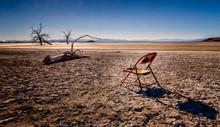 Rusted Chair On Mud Flats At Salton Sea