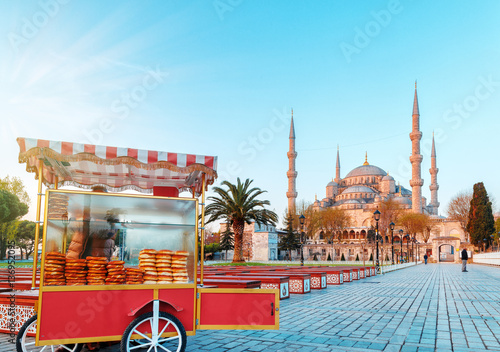 Traditional turkish fast food cart at Blue Mosque Cami background Poster