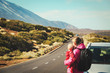 family travel by car-mother with baby on road in mountains