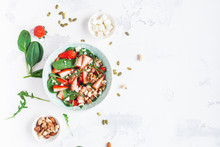 Strawberry Salad. Spinach Leaves, Sliced Strawberries, Nuts, Feta Cheese On White Background. Healthy Food Concept. Fat Lay, Top View
