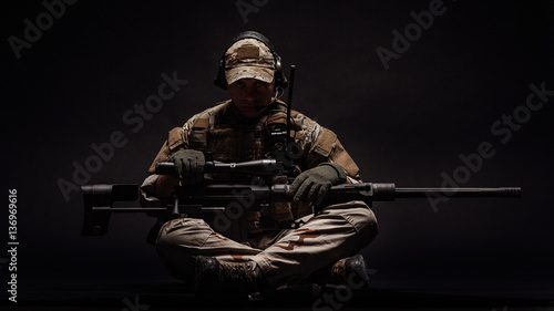 Fotografie, Obraz Portrait soldier or private military contractor holding sniper rifle