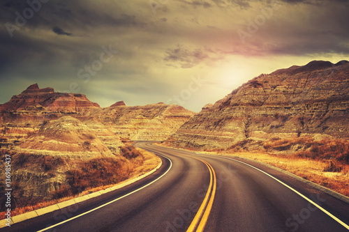 Poster Cappuccino Scenic road at sunset, color toned picture, Badlands National Park, South Dakota, USA.