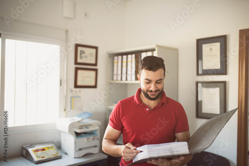 Man working in office Canvas Print