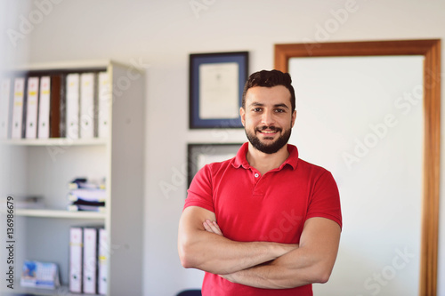 Man working in office posing for picture Canvas Print