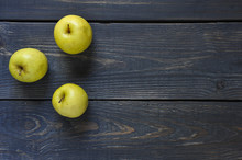 Apple On A Wood Textured Cutting Board