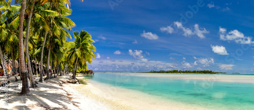 Fotografie, Obraz  Stunning wide angle view of a beautiful beach on the remote island of Aitutaki, north of the main island Rarotonga, Cook Islands