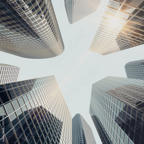 La pose en embrasure Sur le plafond Bottom view of modern skyscrapers in business district in evening light at sunset. Industrial architecture, business construction and estate financial concept, 3d rendering