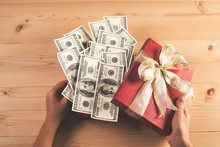 Money In Red Bow Decorated Gift Box.