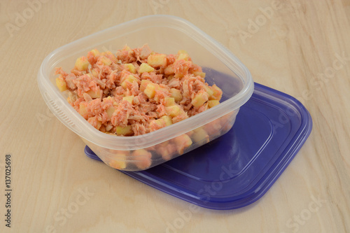 Tuna Salad With Apple And Salad Dressing In Portable Lunch Storage Container